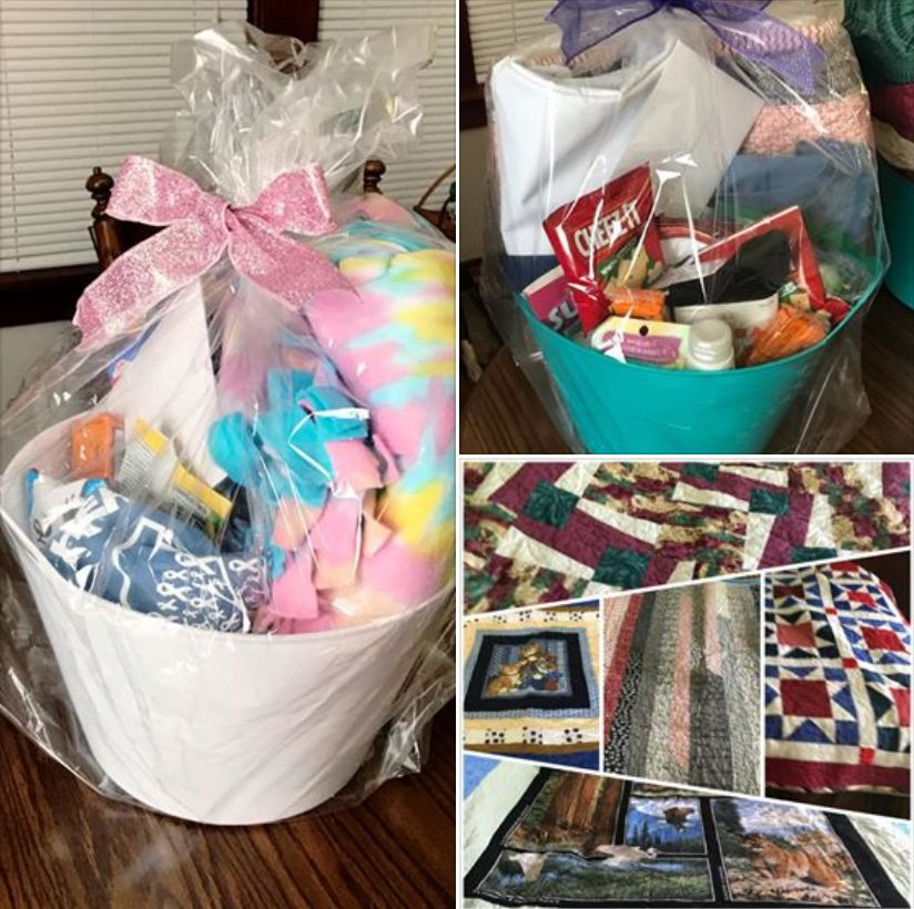 white basket and green basket, each filled with colorful blanket or quilt, blue LRCF tee shirt, bags of snacks, body care products