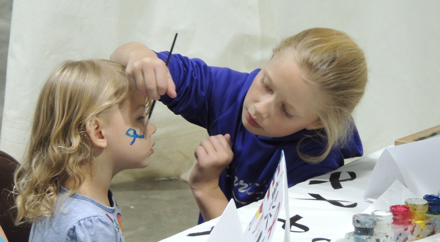 Students from GJHS did face painting.