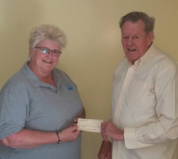 Pictured with Patti Brooks is Kiwanis member Algren Anderson